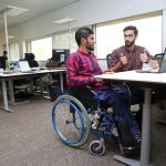 Picture of Two Disabled Persons Working in their Office