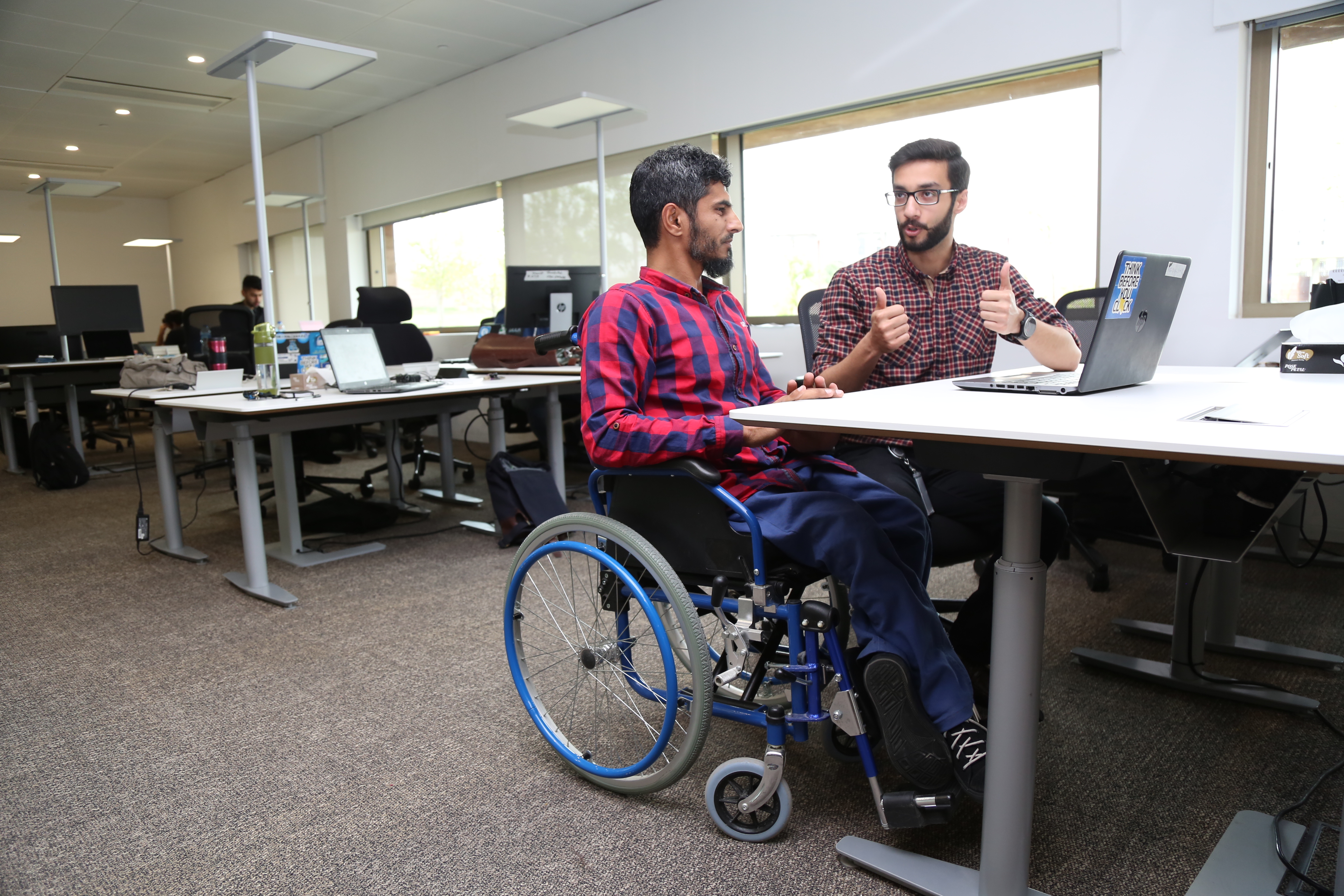 Picture of Two Disabled Persons Working in their Office (Disability Job Center)