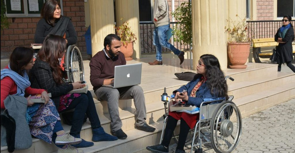 Picture of Adds Shooting in which Some Disabled persons are talking each other.